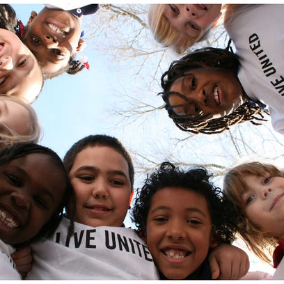 """Kids wearing """"Live United"""" shirts in support of the"""