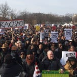 Demonstrators gather in Washington, D.C., to protest recent grand jury decisions in the deaths of Michael Brown and Eric Garner.