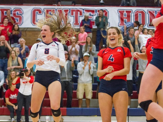 Dixie State volleyball players celebrate after defeating Point Loma 3-0 Saturday, Nov. 7, 2015.