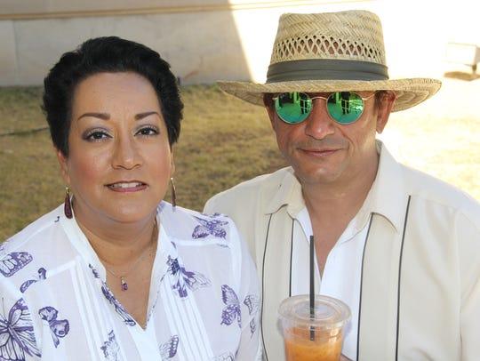 Laura Paez, left, and John Escandon