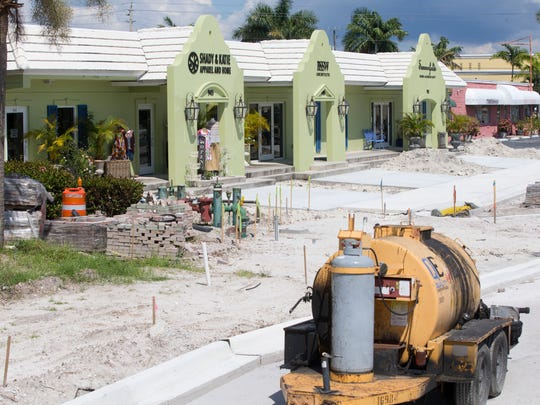 Construction can be seen along Central Avenue, from U.S. 41 to Goodlette-Frank Road, Thursday, Sept. 22, 2016, in downtown Naples. To the relief of business owners along the route, substantial parts of the road are on track to be completed in October.