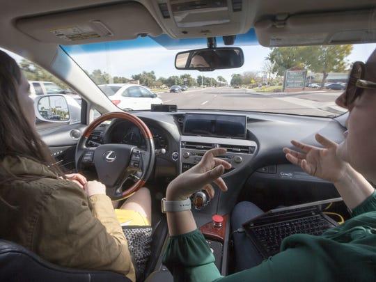Driver Priscilla Knox and Jaime Waydo, a Waymo engineer,