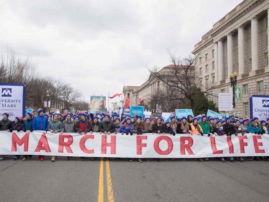 AFP_L55WJ.jpg Pro-life demonstrators march towards