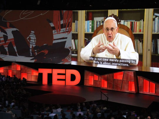 Pope Francis speaks during the TED Conference, urging