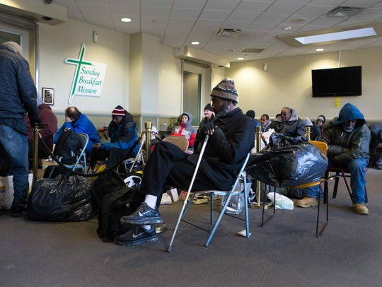 The homeless stay warm inside Sunday Breakfast Mission