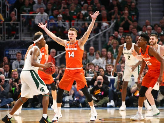 Braedon Bayer guards a Michigan State player during Syracuse's NCAA tournament game on March 18.