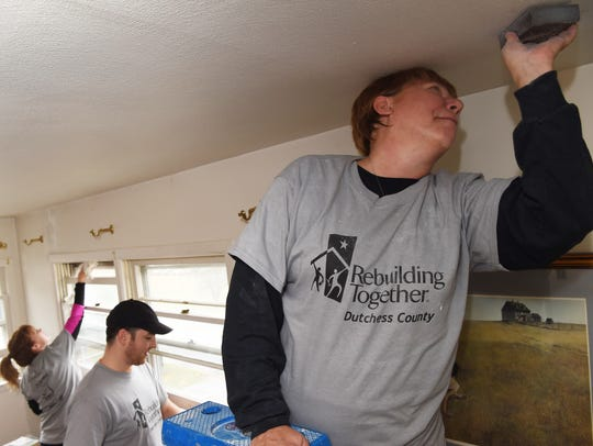 At right, Rebuilding Together Dutchess County volunteer
