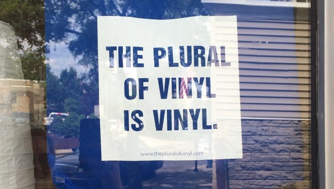 A record store grammar lesson hangs in the window at Dave Frankel's Merchantville record store Inner Grove Records.