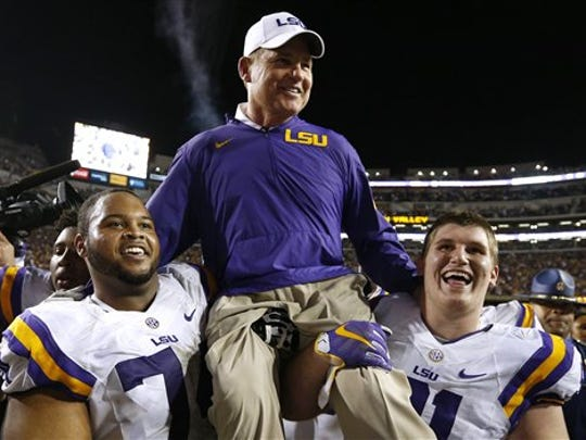 LSU head coach Les Miles is carried off the field after an NCAA college football game against Texas A&M in Baton Rouge.
