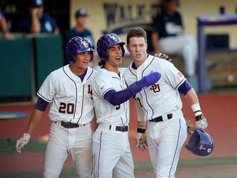 LSU's Greg Deichmann (7) is greeted by Antoine Duplantis (20) and Kramer Robertson (3) after hitting an in-the-park grand slam in the first inning of a college baseball regional tournament against Rice in Baton Rouge, La., Sunday.