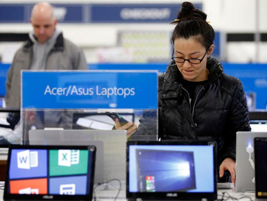 Shoppers browse items at a Best Buy store on Friday,