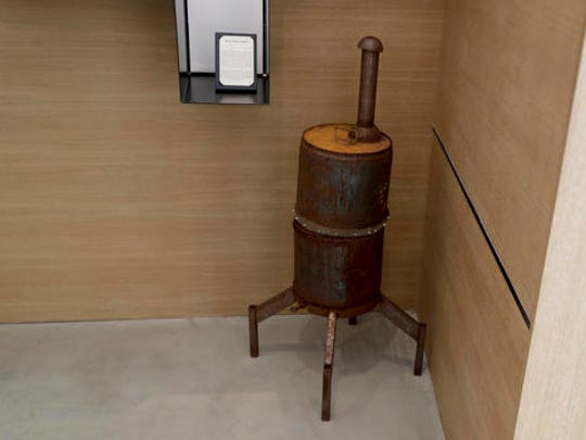 A meat smoker is displayed at the Museum of Broken
