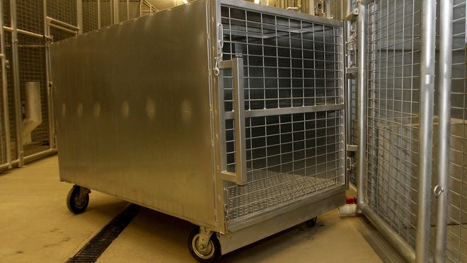 A crate to transfer exotic animals into cages in the large animal enclosure area of the Dangerous Wild Animal Temporary Holding Facility at the Ohio Department of Agriculture.
