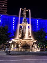The Tyler Davidson Fountain is a bronze and granite structure featuring a graceful, nine-foot-tall icon called the Genius of Water.