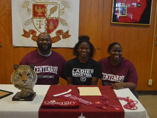 Winnfield senior Kayla King (center) signed with Centenary College Tuesday.