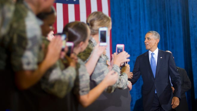 President Barack Obama greets members of the military before taking the stage to speak at US Central Command (CentCom) at MacDill Air Force Base, Fla., Wednesday, Sept. 17, 2014. Obama had earlier consulted with military officials about the U.S. counterterrorism campaign against Islamic State militants. (AP Photo/Pablo Martinez Monsivais)