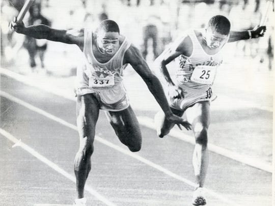 Tennessee's Willie Gault, left, wins the 400-meter relay in 39.23 seconds, a step ahead of Kenny Robinson of Arizona State on June 3, 1983.