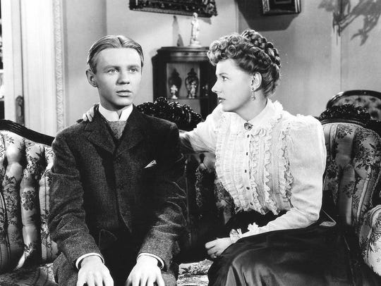 Jimmy Lydon and Irene Dunne in a scene from 'Life with