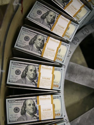 $100 notes are printed at the Bureau of Engraving and Printing on May 20, 2013, in Washington, DC.
