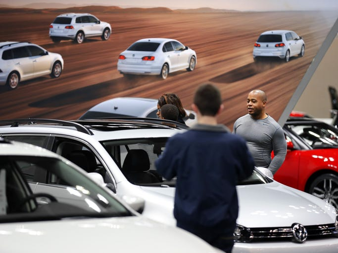 People take in all the newest cars during the 100th Indianapolis Auto Show on Dec. 26, 2013,at the Indiana Convention Center, Indianapolis. America's second-longest running auto show runs through Jan. 1, 2014. Thirty-nine automobile manufacturers are displaying 2014 automobiles, SUVs, light-duty trucks and luxury vans in more than 400,000 square feet of exhibit space.