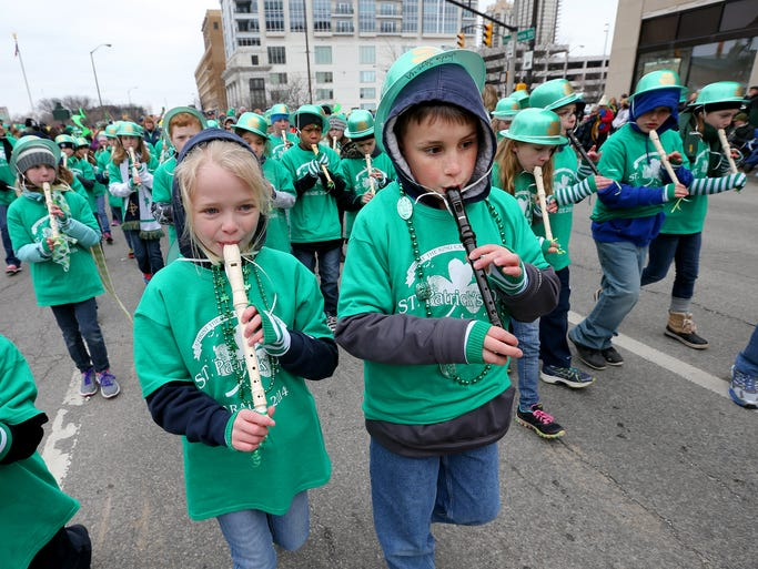 The 34th Annual St. Patrick's Day Parade Monday morning along Pennsylvania Street downtown Indianapolis. Here Christ the King Catholic School's marching recorders make their way down Pennsylvania Street.