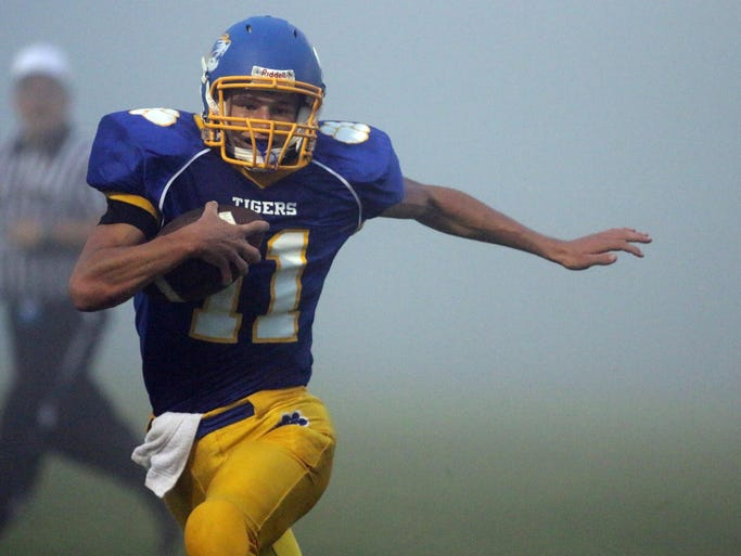 Howards Grove's Luke Stanczyk (11) carries the ball during action Thursday August 21, 2014 at Howards Grove.