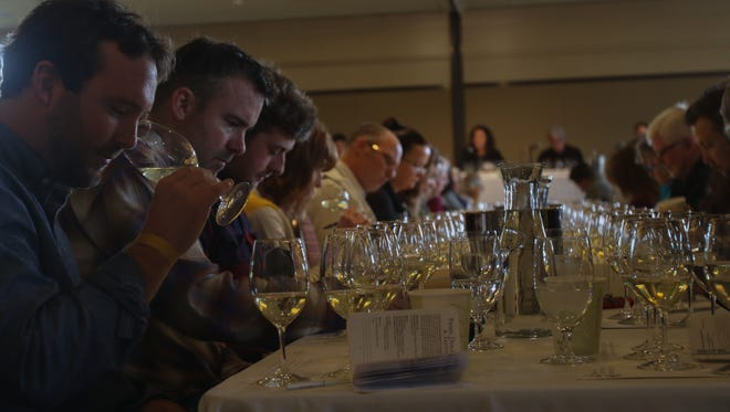 Oregon Chardonnay Celebration participants sample wines during a tasting discussion at The Allison Inn and Spa in Newberg on Saturday, Feb. 27, 2016.