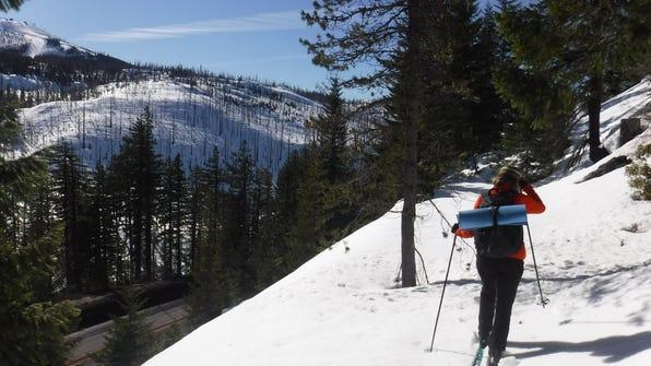Santiam Pass - Daisy LaPoma skis on railroad grade above highway