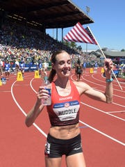 Molly Huddle reacts after winning the women's 10,000