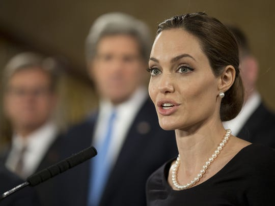 Angelina Jolie, in her role as UN envoy, talks during a news conference regarding sexual violence against women in conflict, at the Foreign Ministers G8 meeting in Lancaster House in 2013 in London, England.