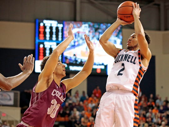 Bucknell's Stephen Brown (2) shoots over Colgate's