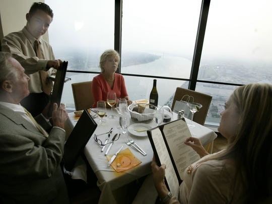 Guests order at Coach Insignia atop the GM Renaissance Center shortly after the restaurant's opening in 2004. Coach Insignia, once the crown jewel of the Epicurean Group portfolio, permanently closed in 2017.