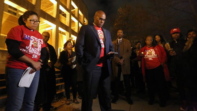 Kenneth Chamberlain Jr. reflects during a song about his father, during the vigil for Kenneth Chamberlain in front of the White Plains Public Safety building, on the 5th anniversary of his death, Nov. 19, 2016.