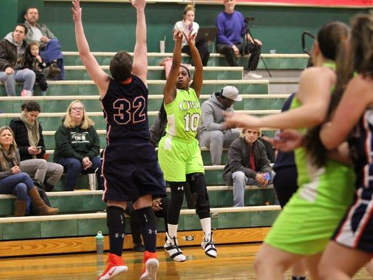 Danasia Dumas puts up a shot from the three-point range