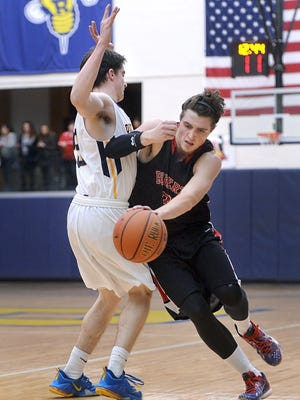 Roberts Wesleyan's Quinn Carey, right, tries to get around the defense of Rochester's Michael Mangan during the men's championship game of the Wendy's College Classic  at the University of Rochester on Dec. 5, 2015.