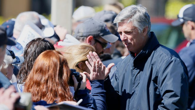 Detroit Tigers general manager Dave Dombrowski high-fives a fan as he signs autographs Feb. 20, 2015, in Lakeland, Fla.