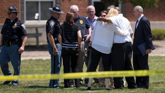 Hugs as top ranking officials meet just before a press conference on the lawn outside Noblesville West Middle School, where a student shot two people with at least one handgun just after 9 a.m., Noblesville, Friday, May 25, 2018. The shooter is in custody, and two people were injured in the shooting at the school.