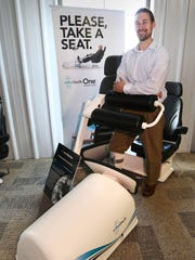 VibeTech CEO and founder Jeff Leismer stands by his creation, the VibeTech chair, Thursday May 12, 2016 in Sheboygan.