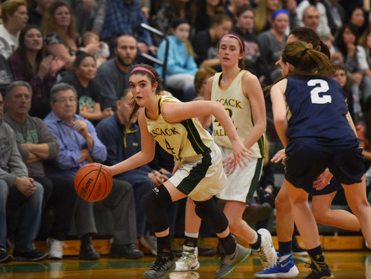 Brianna Smith (no. 4) of Pascack Valley makes her way