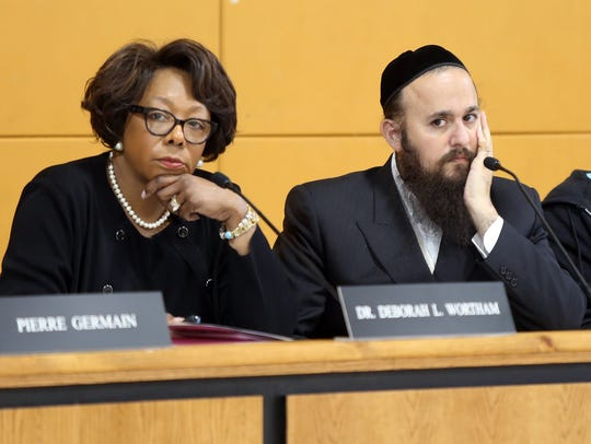 From left, East Ramapo schools Superintendent Deborah L. Wortham and school board President Yehuda Weissmandl listen during budget meeting in Spring Valley on May 8.