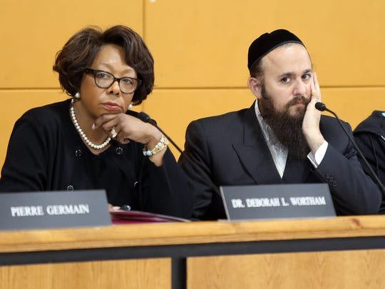 From left, East Ramapo schools Superintendent Deborah L. Wortham and school board President Yehuda Weissmandl listen during budget meeting in Spring Valley on May 8.