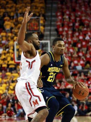 Maryland Terrapins guard Dez Wells (44) defends Michigan Wolverines guard Zak Irvin (21) at Xfinity Center.