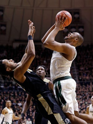 Purdue forward Vince Edwards draws the charge from Michigan State forward Nick Ward in the first half in West Lafayette, Ind., Saturday, Feb. 18, 2017.