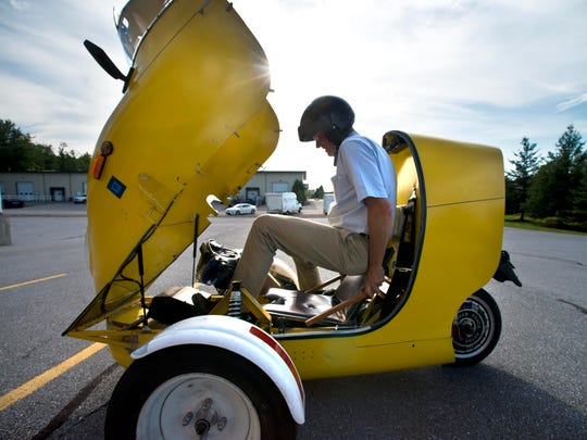 Solo ride: Paul Smith jockeys himself into the all-electric ScooterCar he built in 2008.
