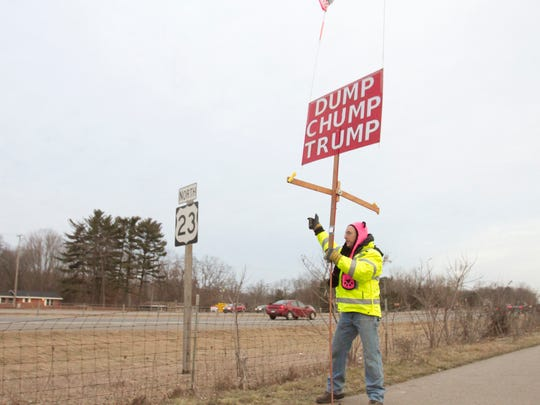 Tom Palmer opted to skip larger protests against President Trump and speak out with a sign he modifies each day with a different slogan. He's surprised by support from passers-by honking in support, particularly truckers, in a predominantly Republican county.