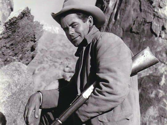 Glenn Ford in publicity shot as cowboy