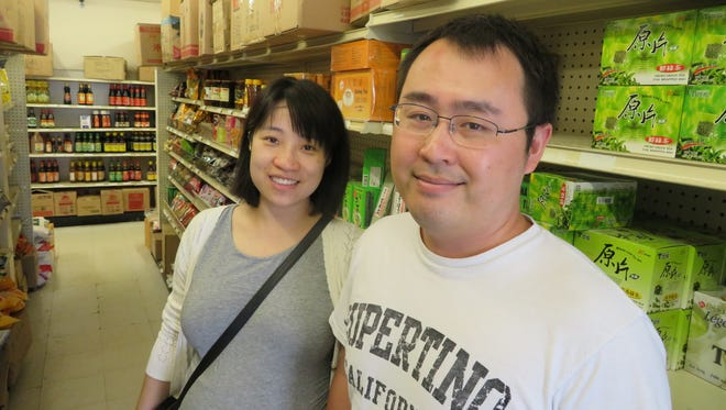 Hui Wang, 30, left, and Miao Hu, 32, moved to Vestal last year when he was appointed to the faculty of the Watson School of Engineering at Binghamton University.