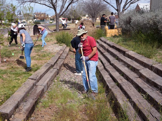 Students with the TRiO and Upward Bound programs at NMSU, along with several faculty, staff and community members, helped clean up the community garden at University United Methodist Church on March 5, 2016.