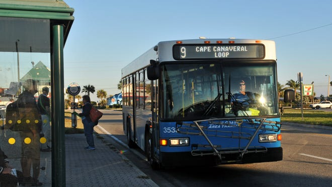 A Space Coast Area Transit bus stops at the Shepard Park stop in Cocoa Beach.