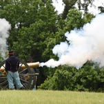 Smoke billows from the barrel of a 12-pound Napoleon cannon during a demonstration at the Vicksburg National Military Park on Sunday.
